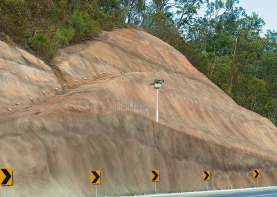 Concrete retaining wall to prevent soil run off and collapse on a highway in Queensland Australia
